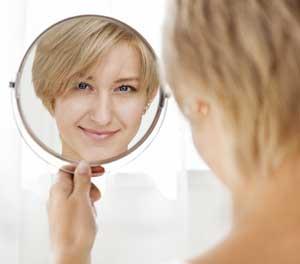 woman-in-mirrorDollarphotoclub_72117509-300x264