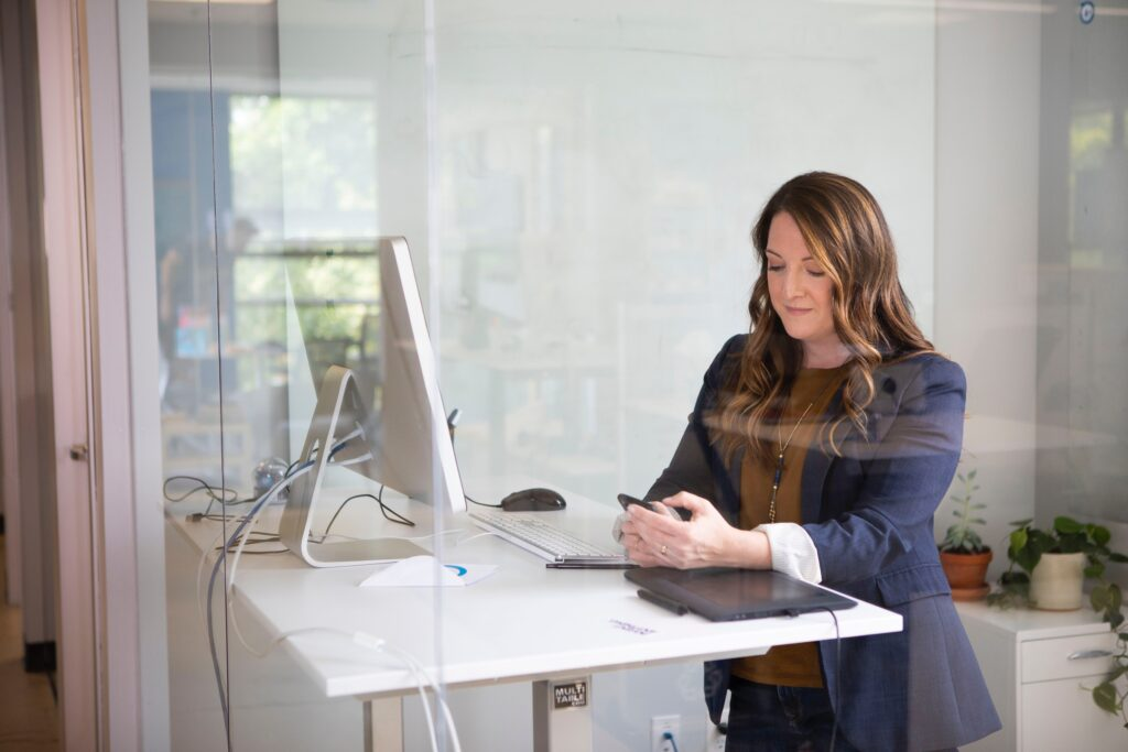 woman with a smartphone sitting at desk